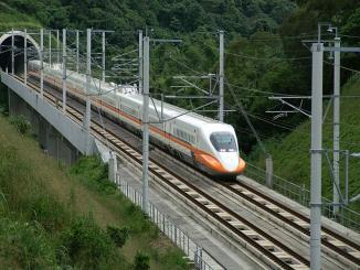 What is the actual cost of the first Bullet train from Mumbai to Ahmadabad
