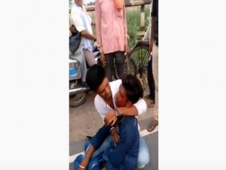 Old video of youth hit on head by UP police viral after new traffic rules