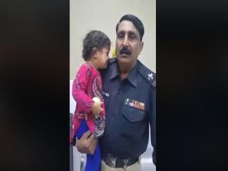 Viral video of Policeman carrying a child speaking Tamil