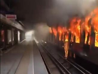 Does a video show American rioters burning a subway train?