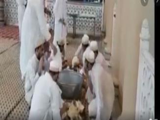 Fact Check: Video Shows Muslims Licking Utensils to Spread Coronavirus